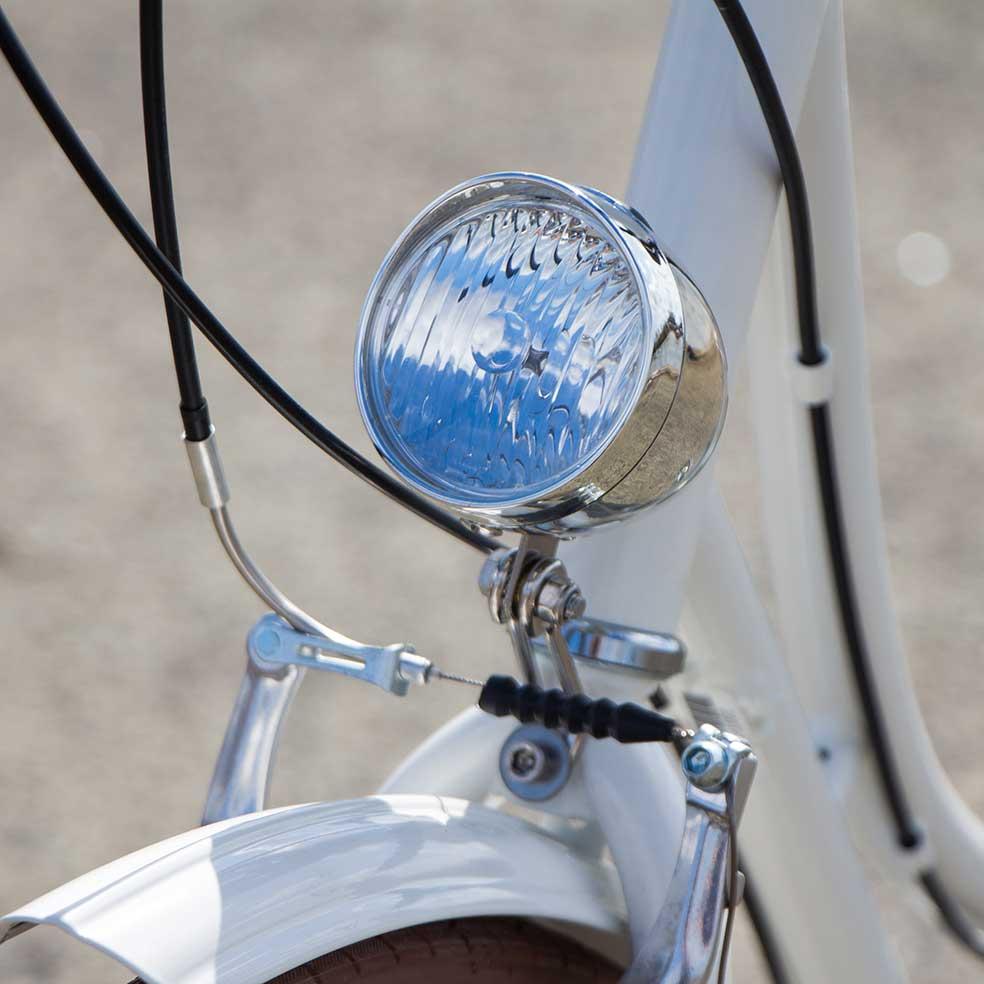 Vélo de ville Coffee mixte. Lumière de ce vélo pour voir et être vu pour vos trajets en ville. Vélotaf, vélo publicitaire et vélo de fonction